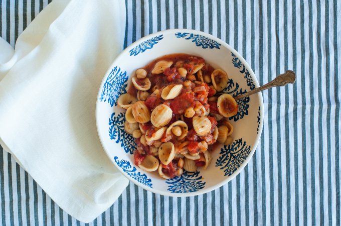This garbanzo bean soup is full of fiber and protein which keeps you full longer. It's also low in fat and calories and has simple delicious rustic flavors. #vegan (ordinaryvegan.net)
