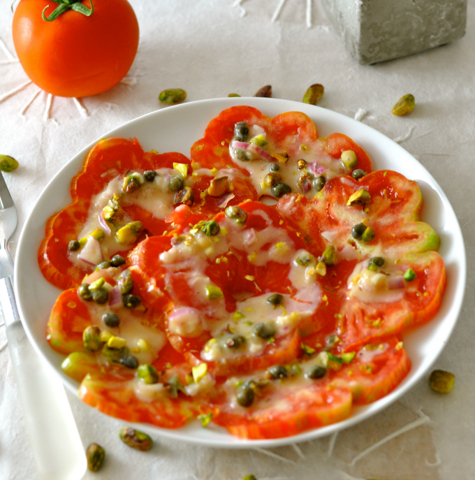 A summer salad you will never forget. Heirloom tomatoes topped with an oil-free pistachio vinaigrette. (#vegan) ordinaryvegan.net